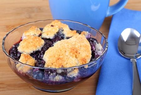 Blueberry cobbler desser in a glass bowl