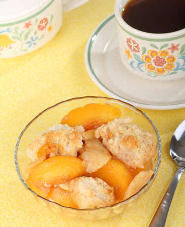 cobbler: Bowl of peach cobbler and a cup of coffee