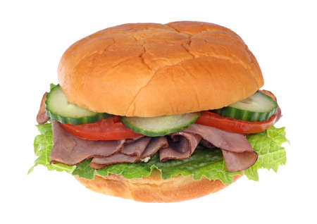 Roast beef sandwich with cucumber, lettuce and tomato isolated on wlhite Stock Photo - 9595533