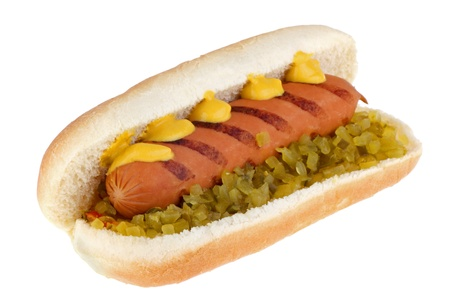 Hot dog with mustard and relish on a bun with potato chips isolated on white