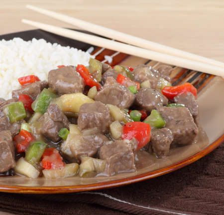 Sweet and sour beef with rice on a plate