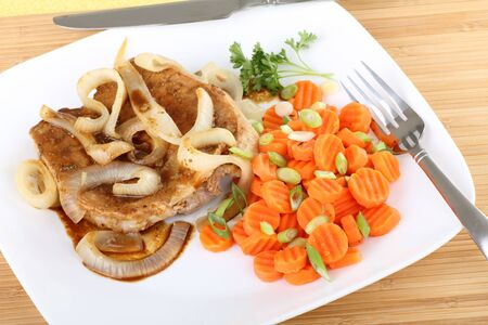 Pork loin dinner with onions and carrots Banco de Imagens