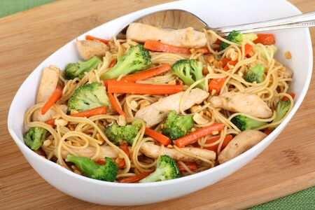 lo mein: Chicken lo mein with carrots and broccoli in a bowl