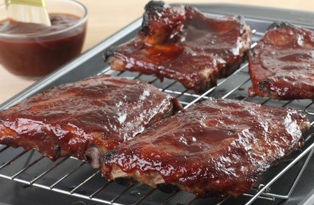 broiling: Barbecue spareribs on a broiling oven rack Stock Photo