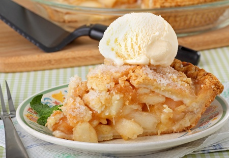 Closeup of a slice of apple pie with a scoop of ice cream