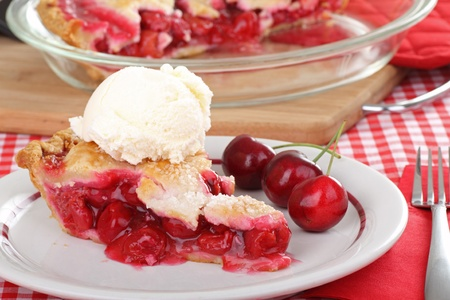 cream pie: Slice of cherry pie with ice cream and cherries on a plate