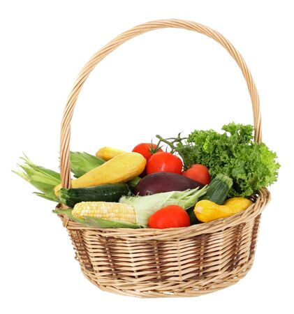 Harvested vegetables and fruits in a basket isolated on white