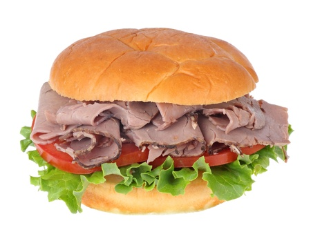 Roast beef sandwich with lettuce and tomato isolated on white