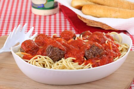 Bowl of spaghetti and meat balls on a serving tray photo
