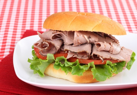 Roast beef sandwich on a red place mat Stock Photo