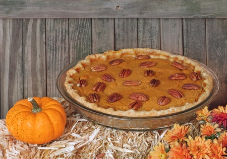 Autumn pumpkin pie with pumpkin and flower Stock Photo