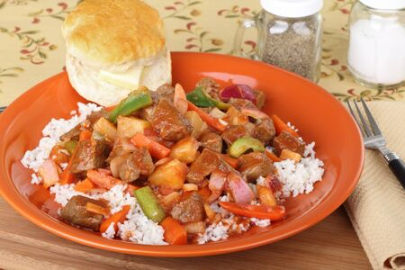 Vegetable beef stew with rice and biscuit
