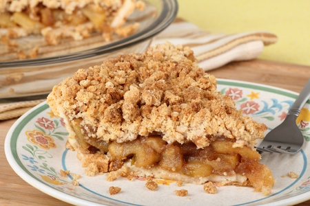 Slice of apple crumb pie on a plate photo