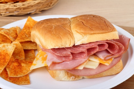Cold cut sandwich made with salami, cheese, bologna, and ham