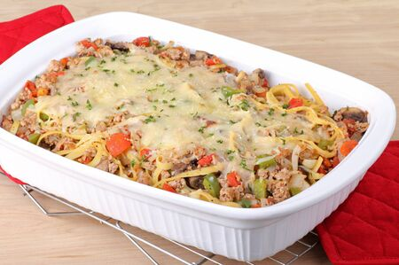 Noodle casserole with melted cheese in a baking dish