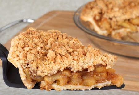 Closeup of a slice of apple pie on a pie server photo