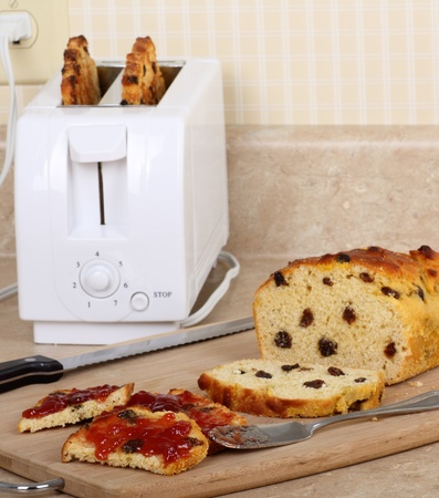 Toasted raisin bread with jam on a kitchen counter photo