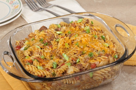 Macaroni and cheese casserole in a glass baking dish photo