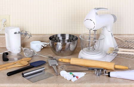 measuring spoons: Assorted baking utensils on a kitchen counter