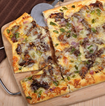 Cheese steak pizza sliced on a tray Stock fotó