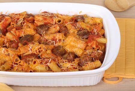 Sausage and pasta rigatoni in a casserole dish