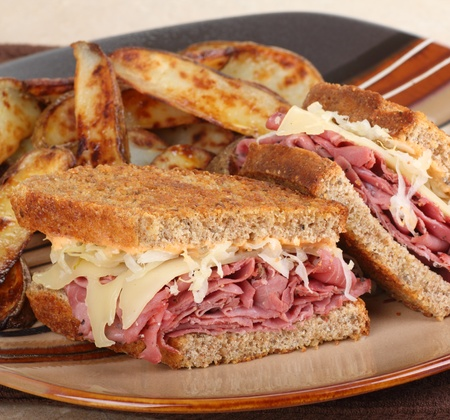 Reuben sandwich with fries on a plate