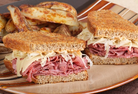 Grilled reuben sandwich with pastrami and swiss cheese on a plate