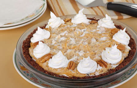 whole pecans: Whole peanut butter pie topped with pecans and whipped cream