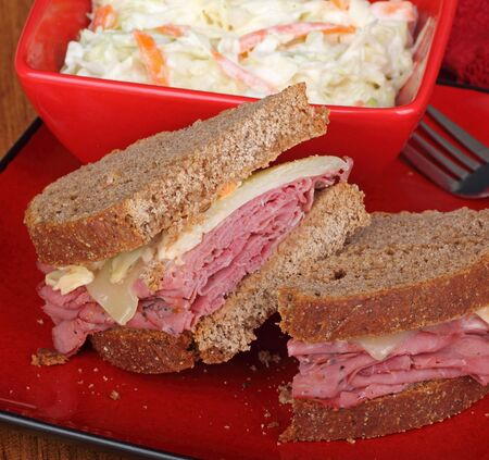 reuben: Pastrami and cheese with rye bread on a plate