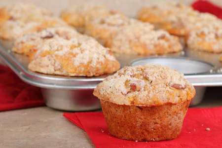 Muffin on a napkin with muffins in a pan Stock Photo - 12517985
