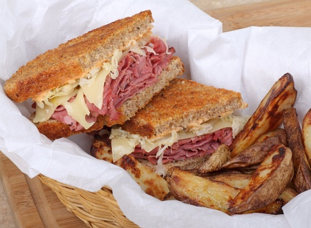reuben: Reuben sandwich and french fries in a basket Stock Photo
