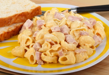 Macaroni and cheese with ham on a plate photo