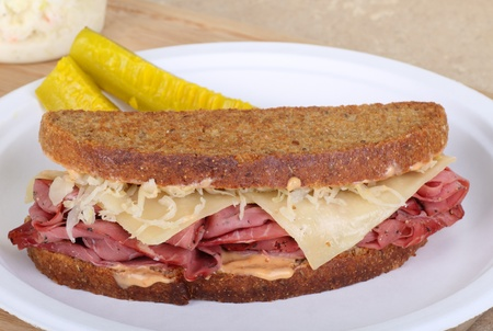 reuben: Grilled pastrami and cheese sandwich on a plate Stock Photo
