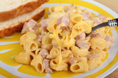 Macaroni and cheese with ham on a fork photo