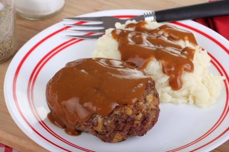Salisbury steak with mash potatoes and gravy photo