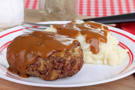 Salisbury steak with mash potatoes covered with gravy Stock Photo