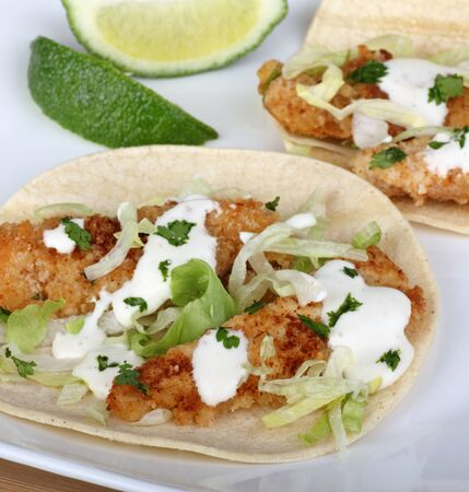 Fish tacos on tortilla shell with lime