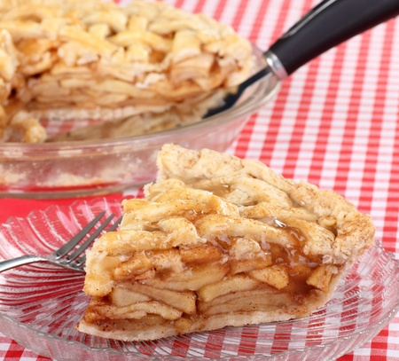 Sliced apple fruit pie on a glass plate photo