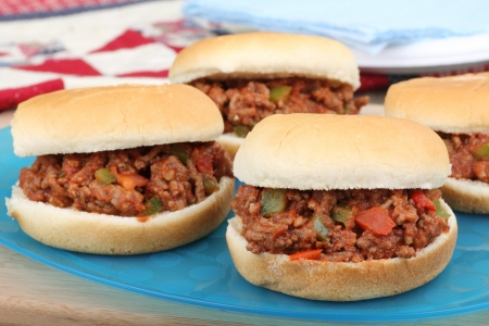 sloppy: Sloppy joes on buns on a platter