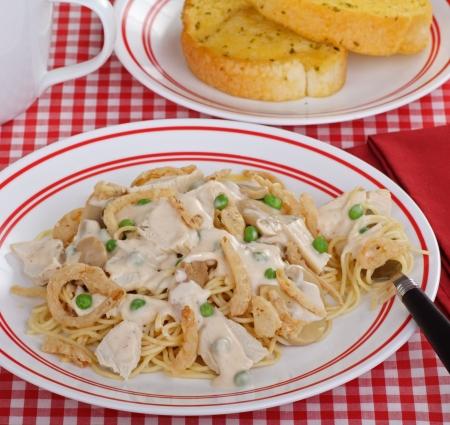 alfredo: Chicken tetrazzini with alfredo sauce over spaghetti