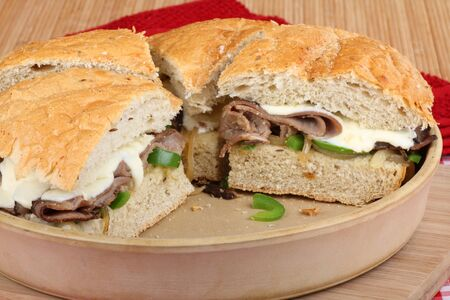 Sliced roast beef sandwiches in a baking dish photo