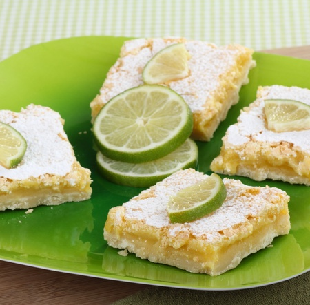 Lime bars on a platter with sliced lime