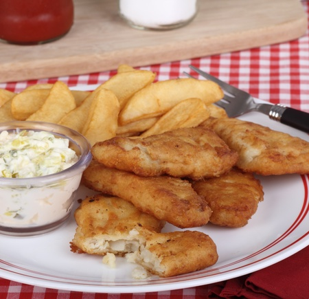 battered: Battered fish fillets and french fries with tartar sauce