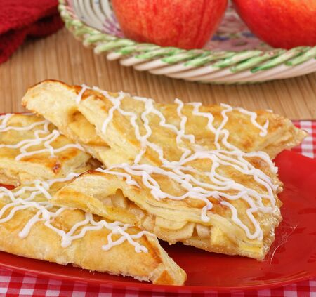 turnover: Apple turnover pastries on a serving plate