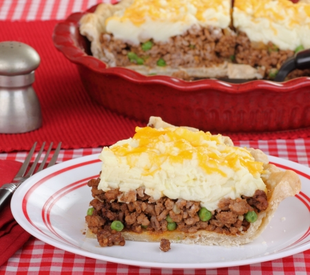 Shepherds pie slice on a plate with serving dish in background Stock Photo - 14619123