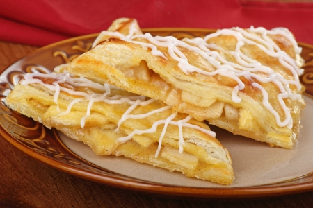 turnover: Two apple turnover pastries on a plate