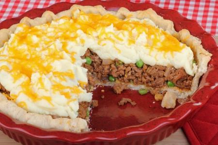 meat pie: Shepherds pie dinner sliced in baking dish