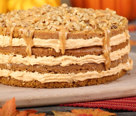 Whole layer pumpkin cake topped with nuts and caramel