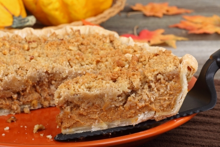 Serving a slice of pumpkin streusel pie photo