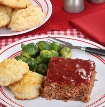 Meatloaf dinner with brussels sprouts and biscuits photo